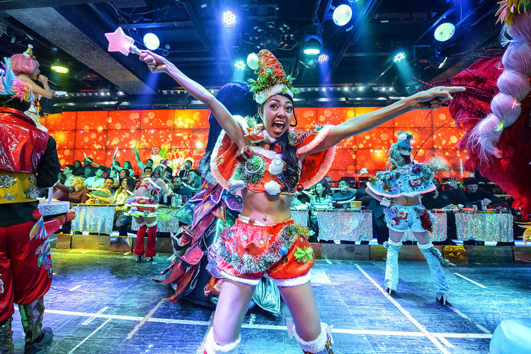 performance at the robot restaurant Adult Adults Only Audience Colourful Crowd Dance Full Length Human Body Part Indoors  Indoors  Kabukicho Multi Colored Music Neon Lights Night People Performance Performer  Robot Restaurant Stage Costume