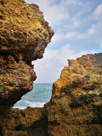 EyeEm Selects Water Sea Beach Cliff Rock - Object Rock Formation Sky Horizon Over Water Eroded