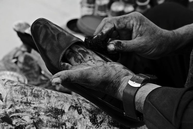 Cropped Image Of Cobbler Working On Shoe
