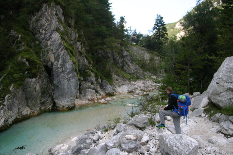 Adventure Backpack Beauty In Nature Day Exploration Hiking Leisure Activity Mountain Nature Outdoors People Real People River Sky Travel Destinations Tree Young Adult