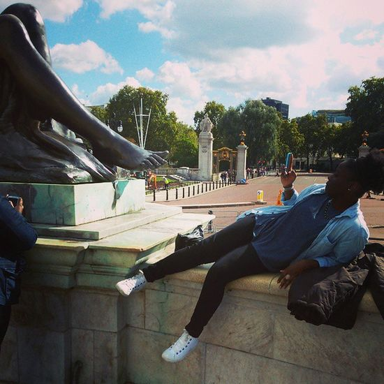 Lol. She's totally looking up the statue's skirt Perv