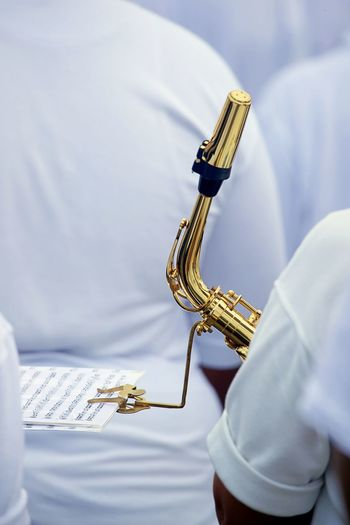 Close-up of man holding musical instrument
