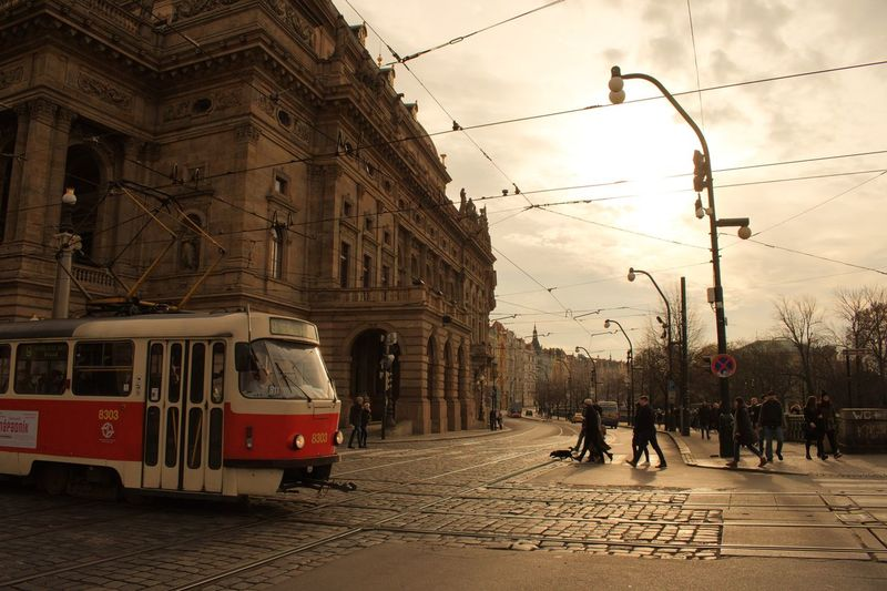 Transportation Street Railroad Track Architecture Built Structure Sky Outdoors Cable Real People Building Exterior Road Land Vehicle Cloud - Sky Public Transportation City Men Day Large Group Of People Women Adult Tram Prague