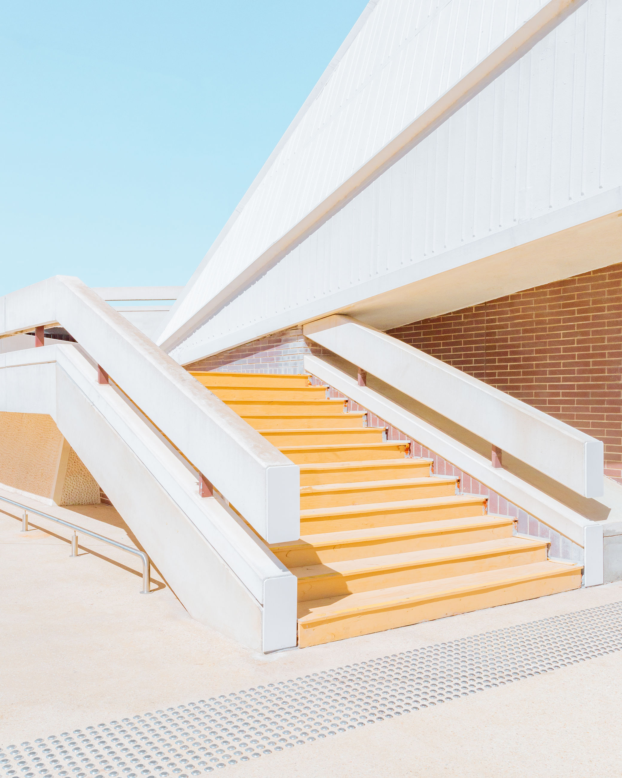 architecture, built structure, staircase, steps and staircases, railing, building exterior, building, no people, sky, nature, sunlight, day, low angle view, white color, clear sky, outdoors, pattern, modern, blue, wall - building feature