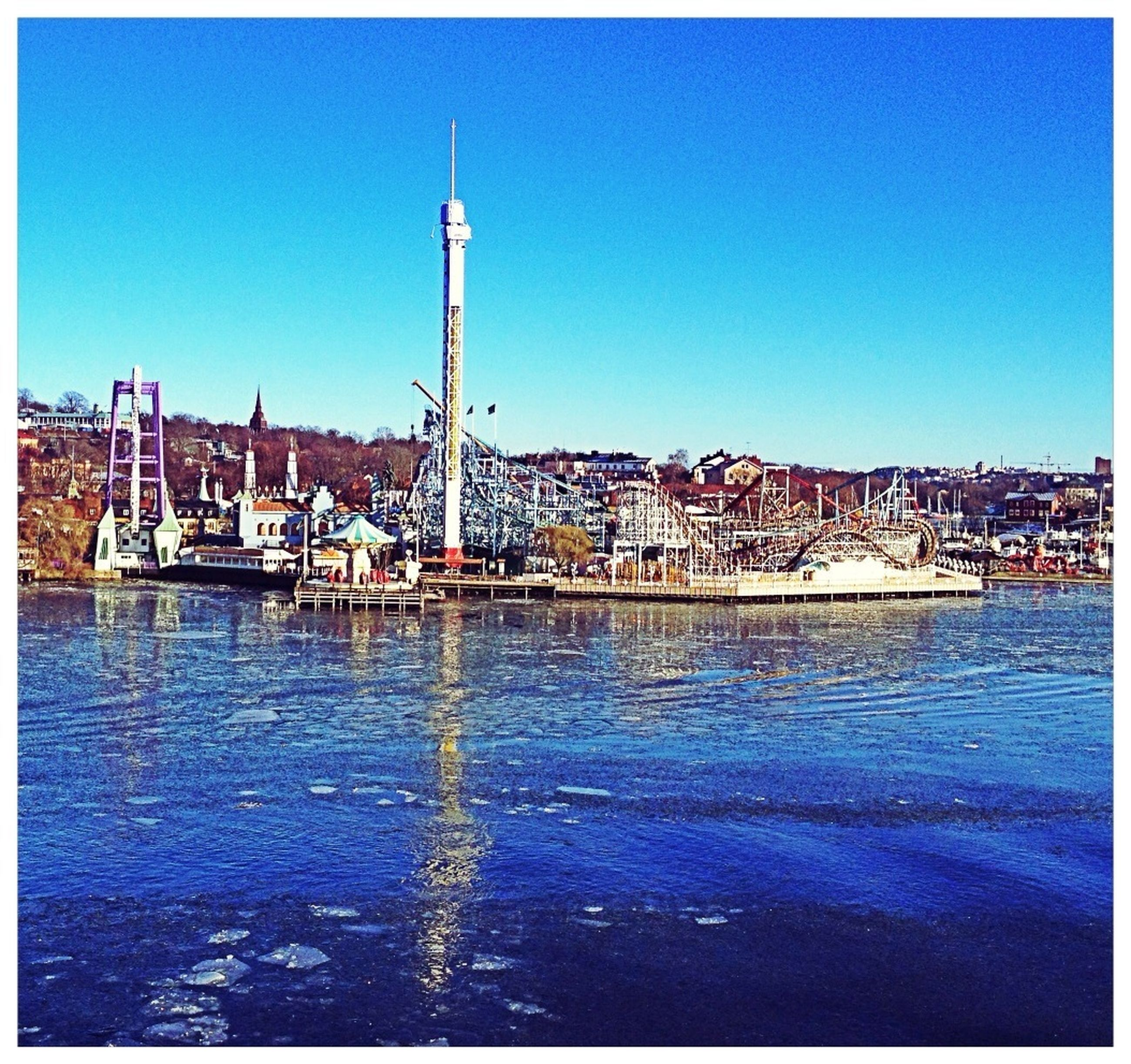water, transfer print, clear sky, building exterior, built structure, architecture, blue, waterfront, auto post production filter, copy space, harbor, sea, nautical vessel, city, river, rippled, moored, outdoors, day, reflection