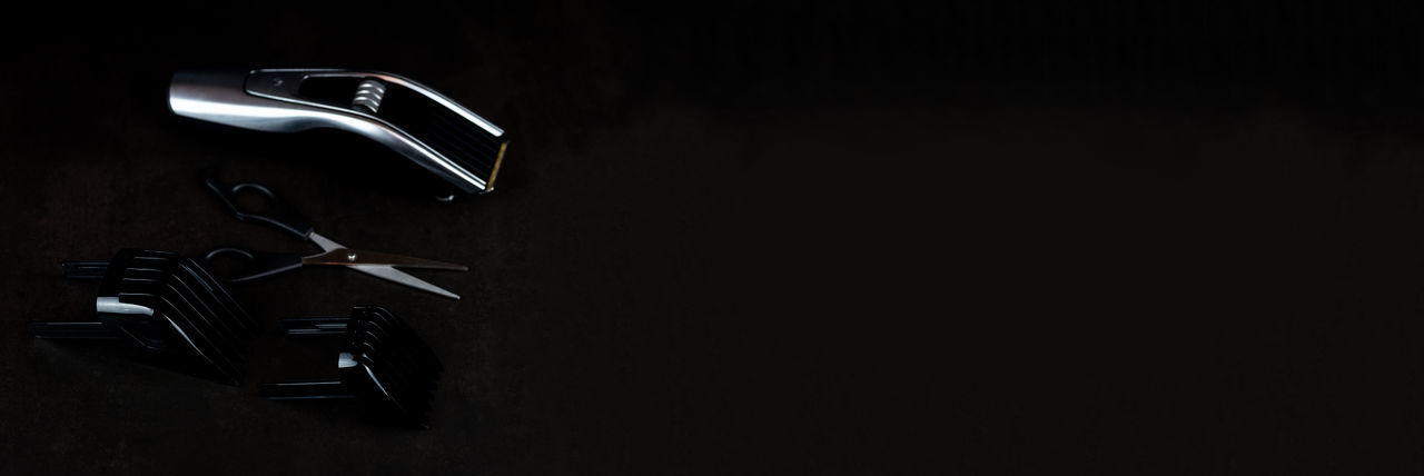 Close-up of electric lamp against black background