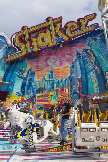 Amusement Park Amusement Park Ride Arts Culture And Entertainment Carousel Day Dom Leisure Activity Outdoors People Real People Shaker Sky Text