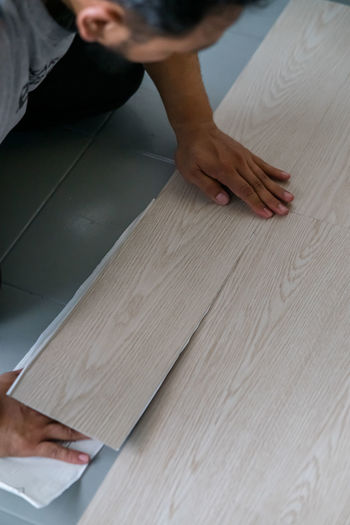 High angle view of carpenter holding plank