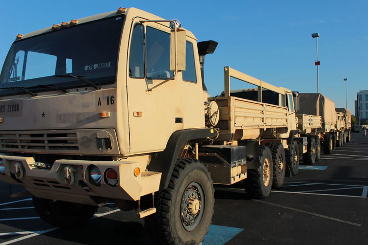 Military Vehicles On Road Against Sky
