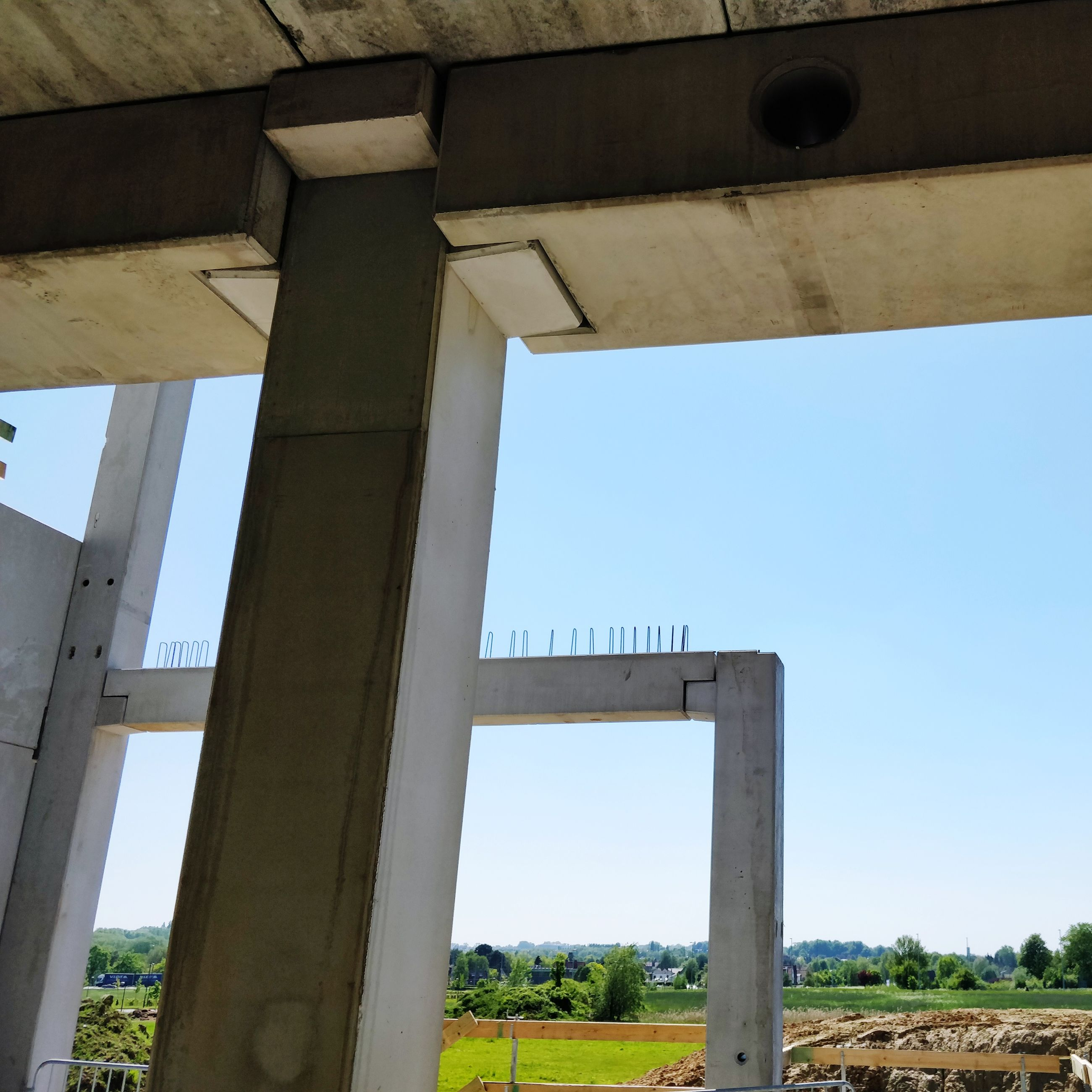 architecture, built structure, sky, day, no people, clear sky, architectural column, nature, bridge, low angle view, bridge - man made structure, transportation, land, connection, outdoors, field, plant, blue, building exterior