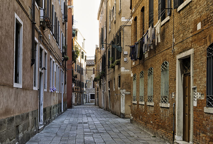 Typical old empty halley in the city of Venice, Italy. Antique Exterior Exteriors Red Venetian Architecture Bricks Buildings City Colorful Empty Facades Halley Historical History Italian Italy No People Old Passage Street Traditional Venice Vintage Walkway
