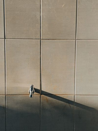 Shadow of people walking on footpath