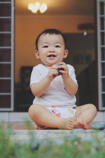 Cute Playful Boy Sitting At Porch