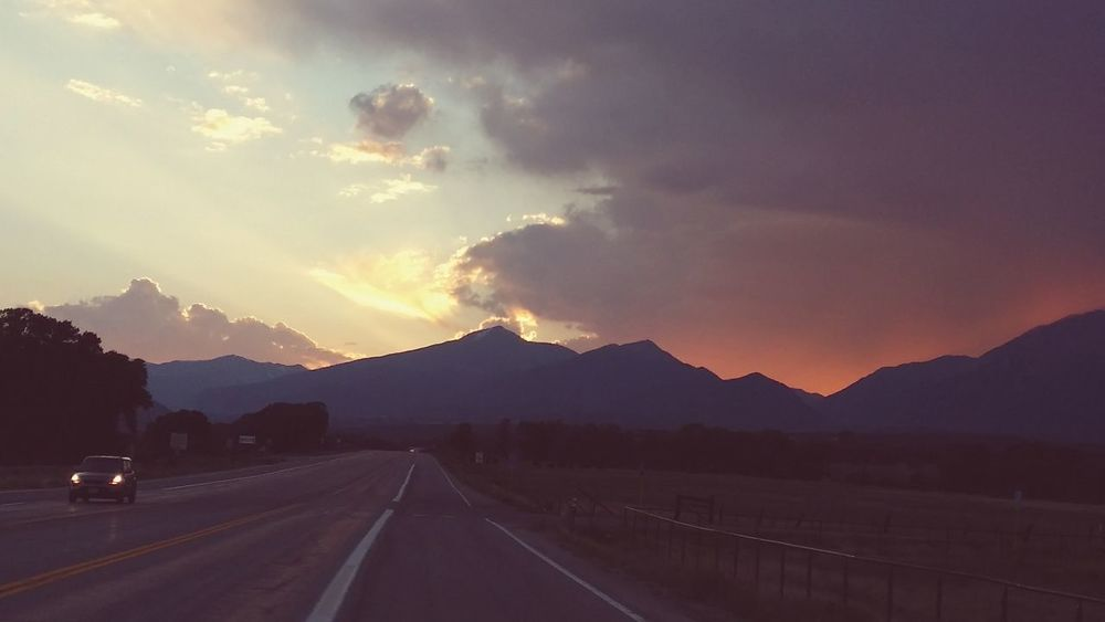 Beauty In Nature Cloud - Sky Clouds Colorado Colorado Photography Country Road Mountain Mountain Range Nature Outdoors Pink Skys Remote Road Scenics Sky Sunset