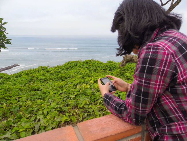 18 - 25 Ye Beach Casual Clothing Cellphone Green Color Horizon Over Water Sea Sky Texting Tranquil Scene Tranquility Water