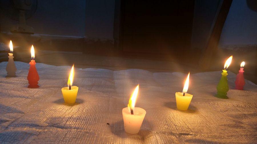Close-up of burning candles at home
