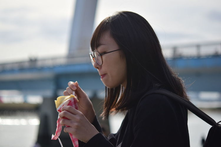 Portrait of young woman holding ice cream