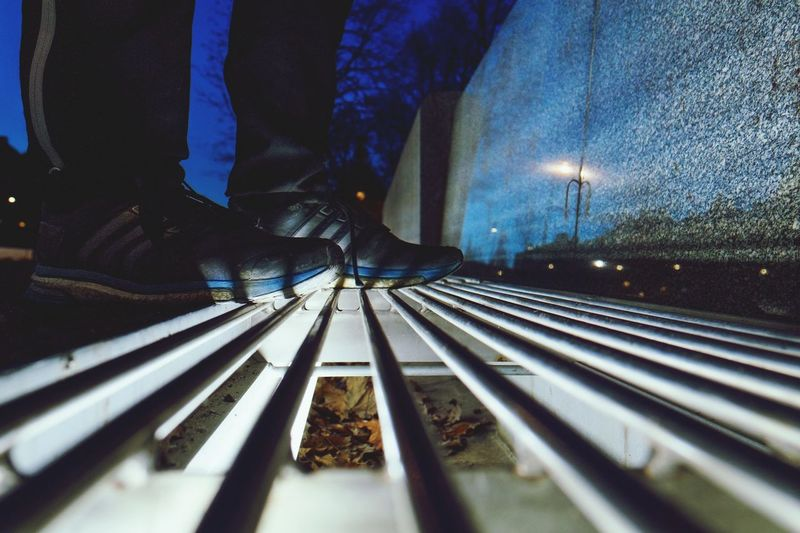 Low section of man on railroad tracks at night