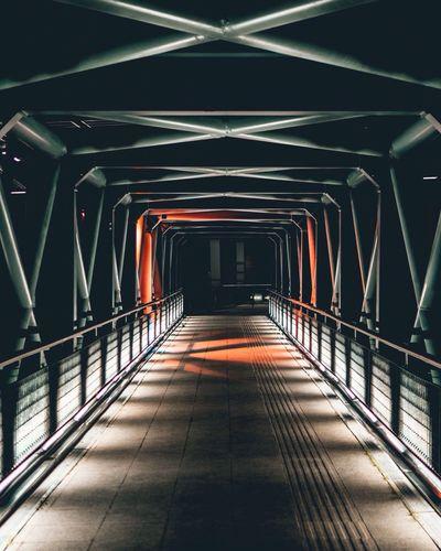 Empty covered bridge at night