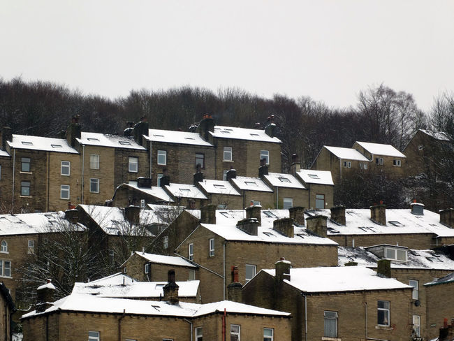 snow on the roofs of terraced houses in hebden bridge Hebden Bridge Yorkshire Architecture Bare Tree Building Exterior Built Structure Clear Sky Cold Temperature Day Nature No People Outdoors Rooftops Sky Snow Tree Village Weather Winter