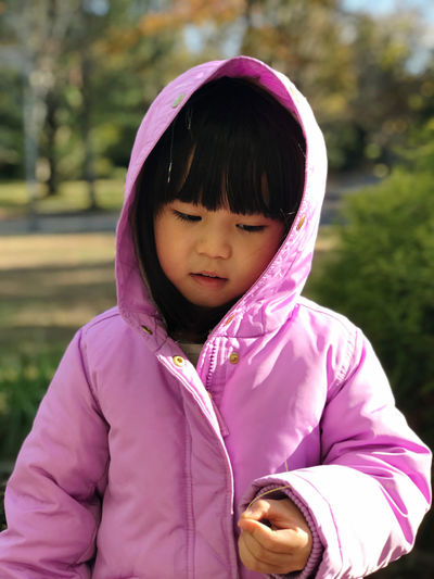 Cute girl wearing hoodie outdoors