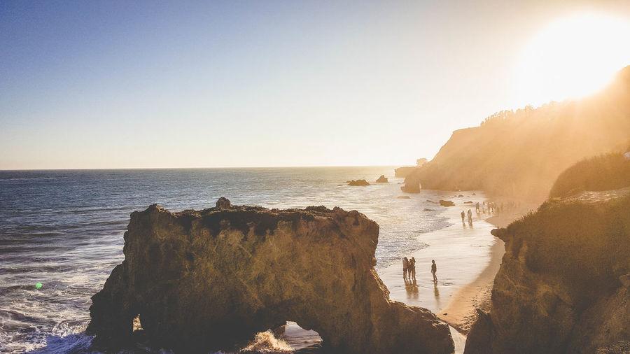 Rock Formations At El Matador Beach Against Sky On Sunny Day