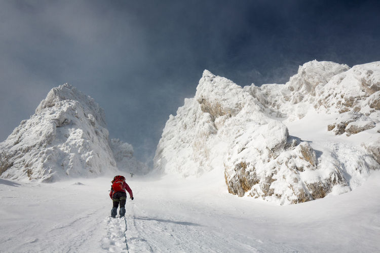 Rear View Of Man Skiing On Snowcapped Mountain