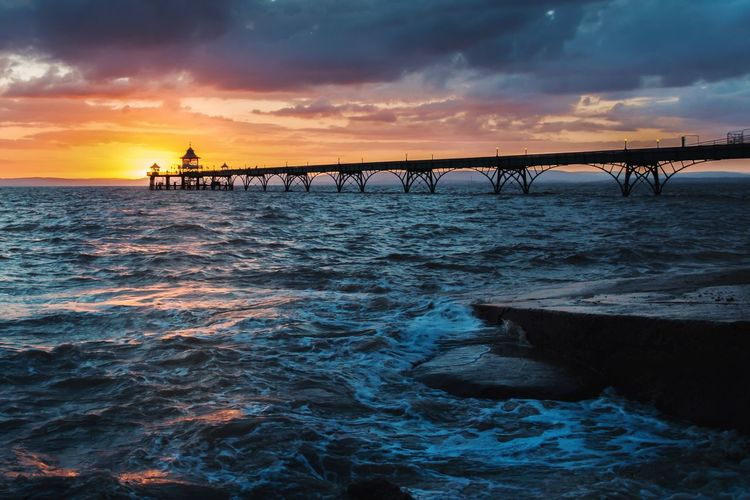 Low Angle View Of Clevedon Pier Against Cloudy Sky During Sunset