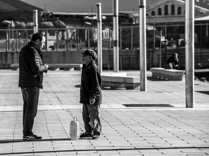 Blackandwhite Black And White Black & White Black&white Black&white Photography Street Streetphotography Street Photography Two People Real People Full Length Footpath Day Women Adult City Men Architecture Walking People Togetherness Lifestyles Leisure Activity Sidewalk Focus On Foreground Building Exterior Side View Outdoors Warm Clothing Paving Stone