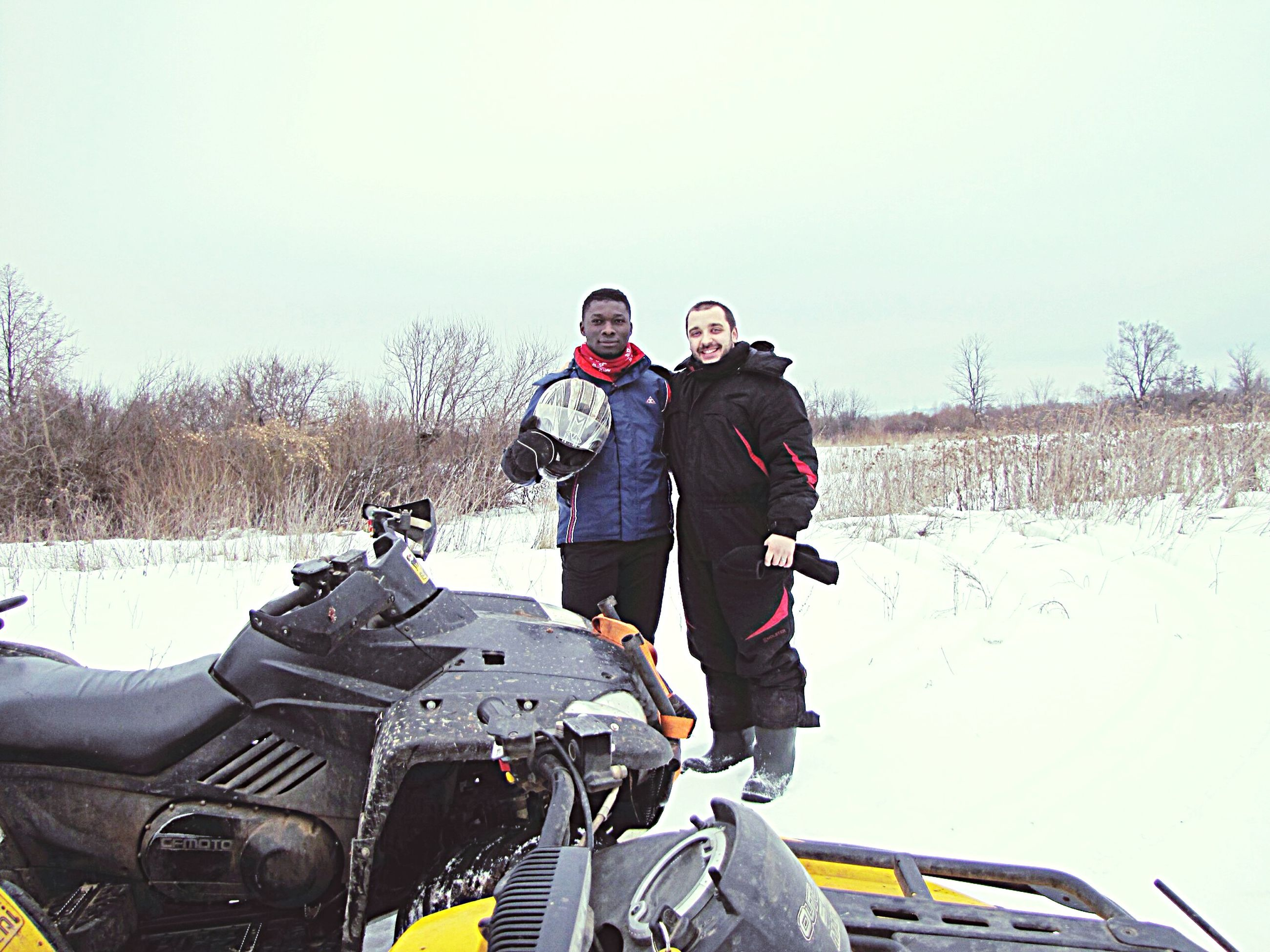 lifestyles, leisure activity, clear sky, casual clothing, transportation, winter, mode of transport, land vehicle, person, young men, men, snow, cold temperature, copy space, young adult, standing, warm clothing, full length