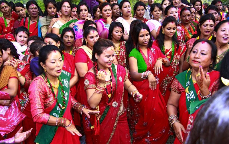 Women taking full day fast celebrating Teej Festival for their husband's wellness or to get a nice husband. Close-up Colorful Colors Of Carnival Dance Enjoyment Fasting Friendship Full Frame Life Style Side By Side Teej Fest Togetherness Tradition Traditional Clothing Women Festival Season Carnival Crowds And Details