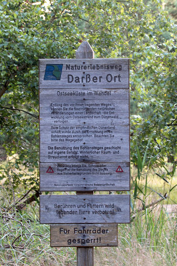 Calm EyEmNewHere Nature Reserve Travel Darßer Ort Germany Information Information Sign Landscape Nature Adventure Trail Nature Experiences Nature_collection No People Relax Tourism Wood - Material