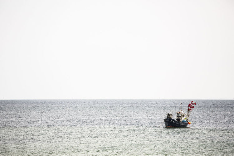 Baltic Sea Deep Water Fishing Net Food And Drink Water Reflections Beach Clear Sky Day Fish Fishing Boat Fishing Industry Horizon Horizon Over Water Men Mode Of Transportation Nature Nautical Vessel Ocean Sailing Salty Water Sea Sky Transportation Water Waterfront
