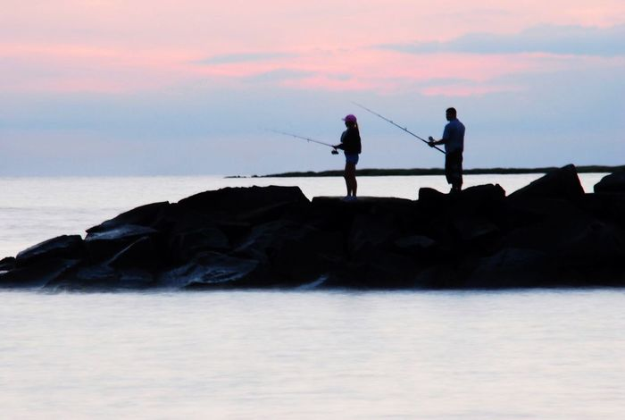 Sea Silhouette Real People Nature Water Sky Sunset Leisure Activity Men Outdoors Fishing Sport Scenics Lifestyles Beauty In Nature Tranquility Standing Two People Horizon Over Water Full Length New Jersey Photography EyeEm Nature Lover Tranquility Natural Patterns People Fishing Breathing Space
