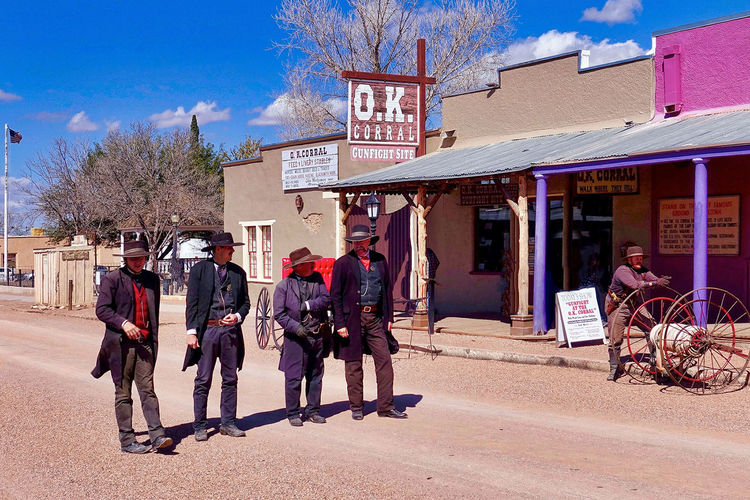 Tombstone in the USA is famous for the gunfight at O.K. Corral where three men died. Arizona Doc Holliday O.K. Corral Trees USA Wyatt Erp Building Clouds Day Gunfight Men Outdoors Real People Sky Street Tombstone
