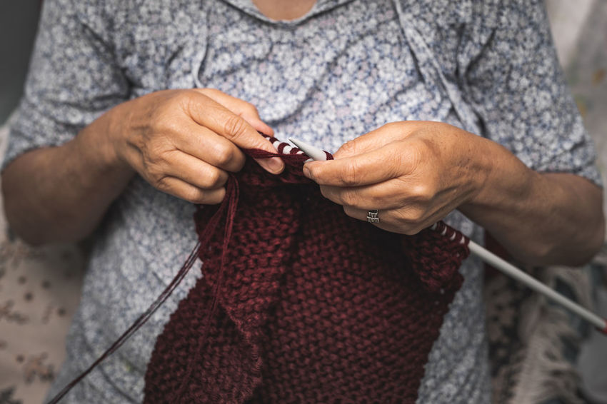 close up of old woman's hands knitting Preparation  Ball Of Wool Focus On Foreground Material Creativity Clothing Front View Adult One Person Close-up Art And Craft Skill  Hand Midsection Textile Holding Human Hand Craft Knitting Needle Knitting Wool Skill  Real People Leisure Activity Preparation