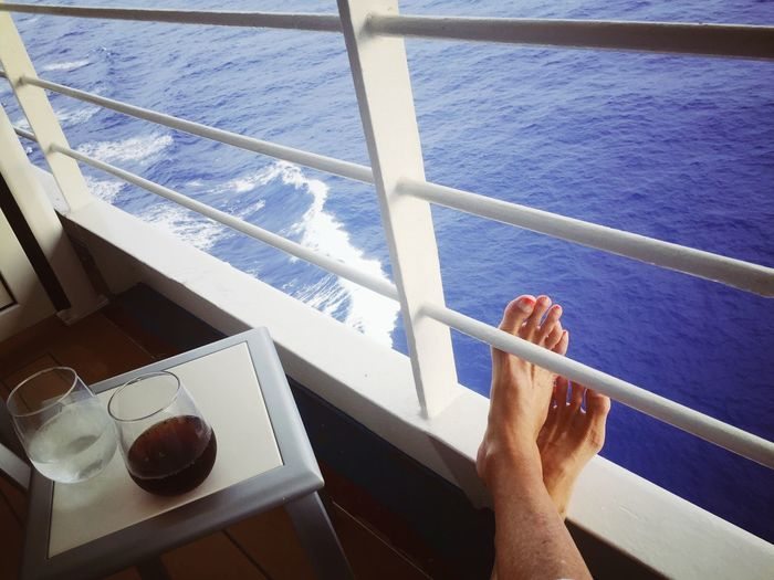 Cropped Image Of Person Legs On Deck Of Ferry Boat