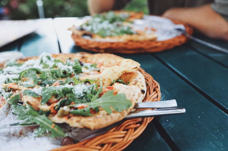 Rustic Style Table Backyard Garden Pizzas Rucola Pizza Time Parmesan Cheese Food Delicious Baked Outdoors Restaurant Pizzeria Food And Drink Food Freshness Ready-to-eat Plate Still Life Healthy Eating Eating Utensil Selective Focus Table Kitchen Utensil Serving Size Bread Vegetable Close-up Fork Focus On Foreground