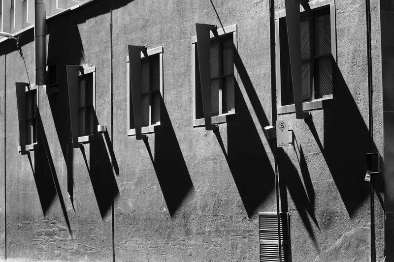 Architecture Building Building Exterior Built Structure Clothesline Clothing Day Drying Hanging In A Row Laundry Low Angle View Nature No People Outdoors Shadow Side By Side Sunlight Wall - Building Feature Walls Window
