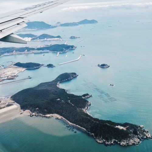 High angle view of airplane flying over sea