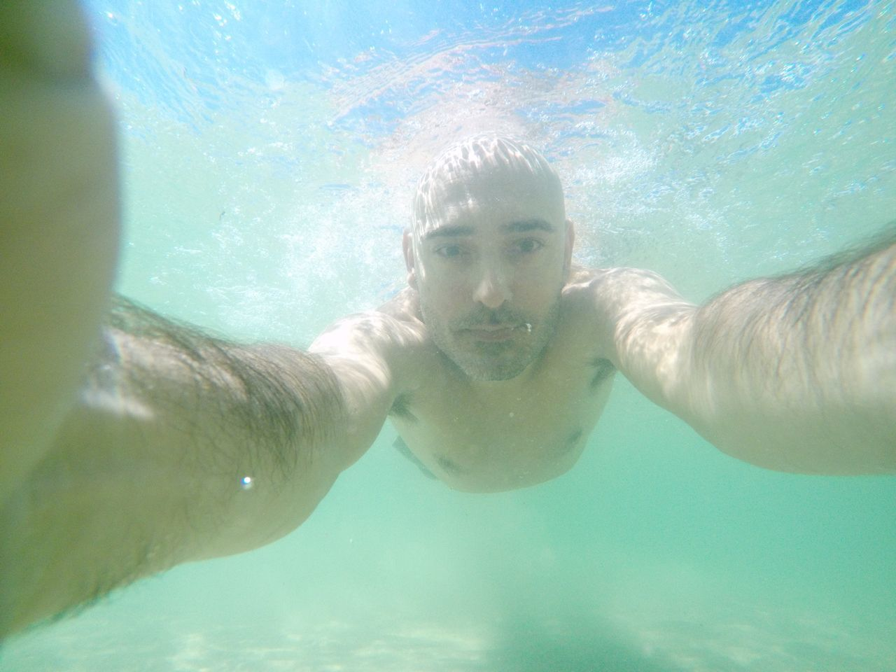 water, underwater, swimming, young adult, one person, portrait, looking at camera, lifestyles, leisure activity, young men, real people, swimming pool, healthy lifestyle, young women, undersea, shirtless, day, sea, selfie, nature, outdoors, close-up, mammal, people