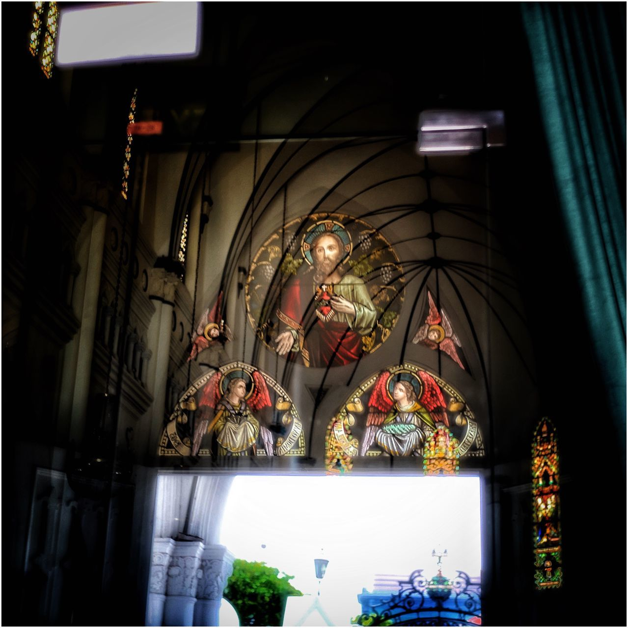 indoors, religion, spirituality, illuminated, place of worship, no people, hanging, statue, day