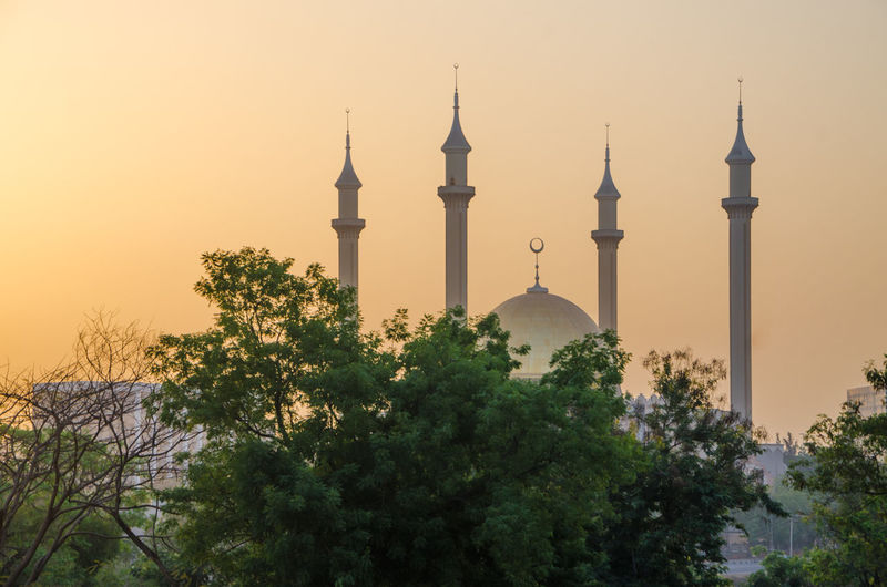 National mosque of abuja against sky during sunset