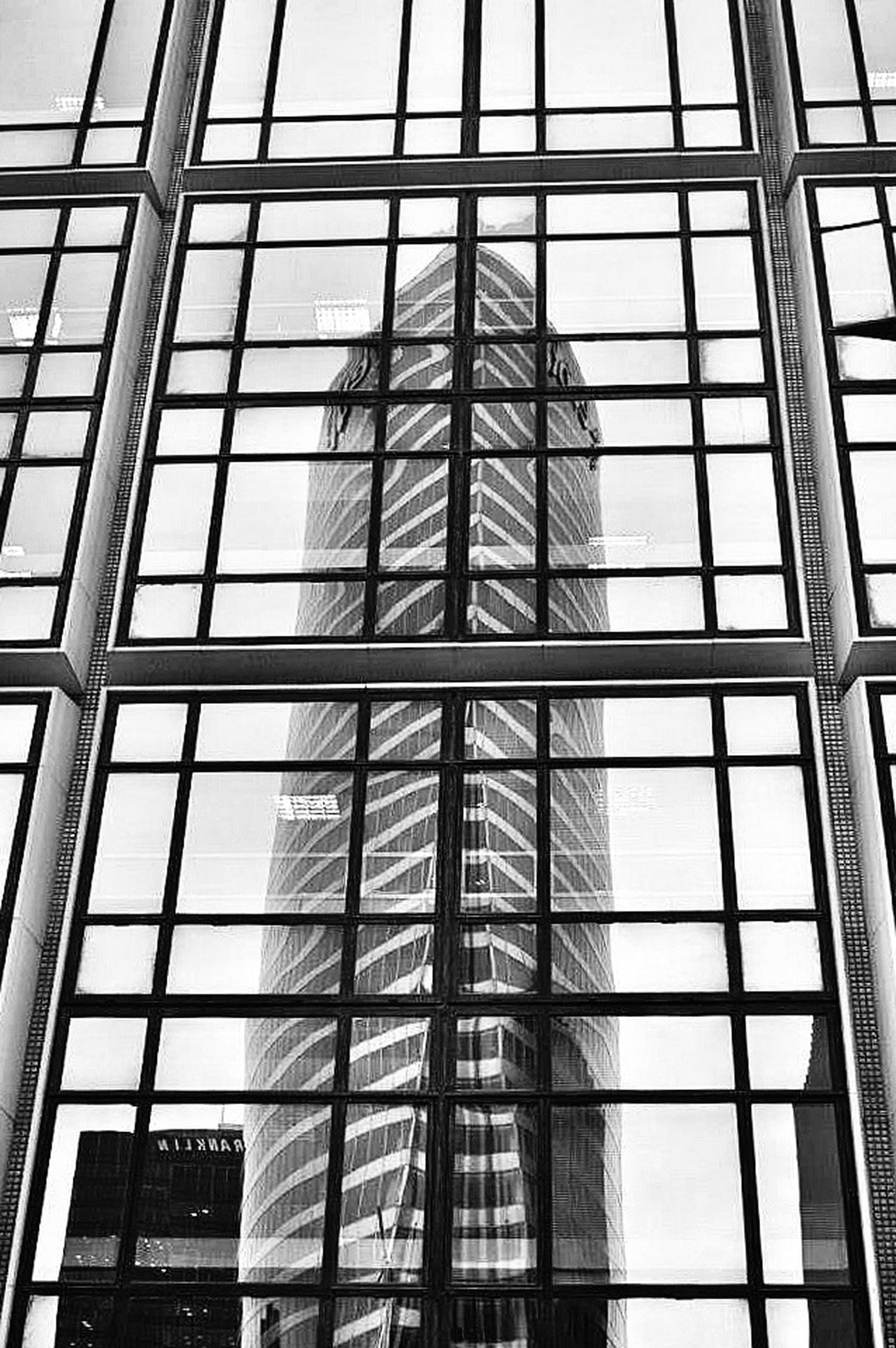 architecture, glass - material, built structure, modern, building exterior, low angle view, window, office building, transparent, reflection, city, skyscraper, glass, indoors, tall - high, sky, building, tower, day, architectural feature