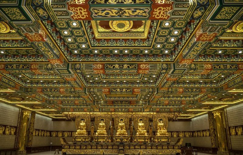 "Frontal view of the interior of ""Ten thousands Buddha"" monastery in Hong Kong, situated in the middle of the sacred area on Lantau Island."