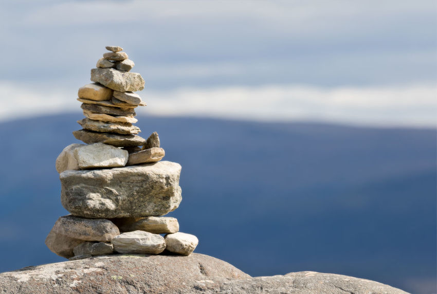 pile of rocks on a mountain top Balance Close-up Day Focus On Foreground Mountain Peak Nature No People Outdoors Pebble Pile Pile Of Stones Rock - Object Sculpture Sky Stack Water