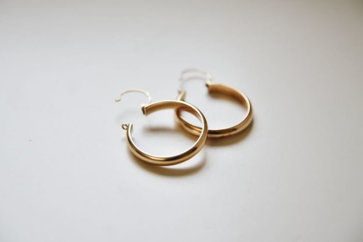 Close-up of wedding rings on table against white background