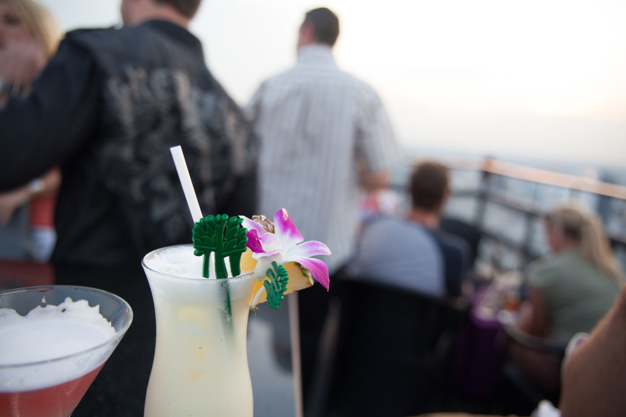 Close-up of refreshing drinks with people in background at restaurant