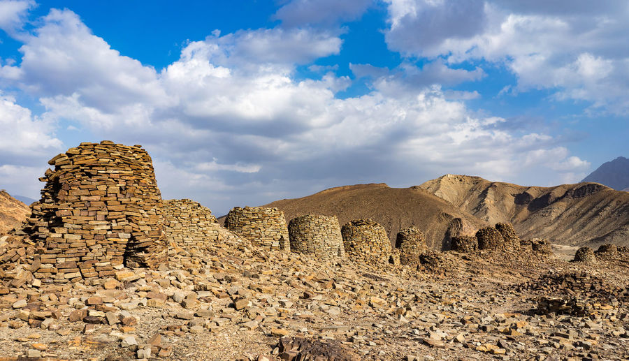 Sky Cloud - Sky Rock Solid Rock - Object Scenics - Nature Tranquil Scene Tranquility Rock Formation Non-urban Scene Beauty In Nature Nature Environment Landscape No People Physical Geography Mountain Geology Land Day Climate Arid Climate Outdoors Formation Eroded Oman Ibri Al Ayn Beehive Tombs