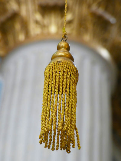 Close-up of yellow decoration hanging on tree